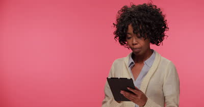 stock-footage-young-african-american-black-woman-using-tablet-pc-computer