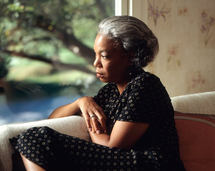 17072-an-african-american-woman-looking-out-a-window-pv